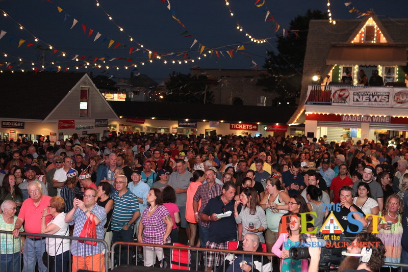 Photo: Feast-goers gather for a musical performance at the Feast