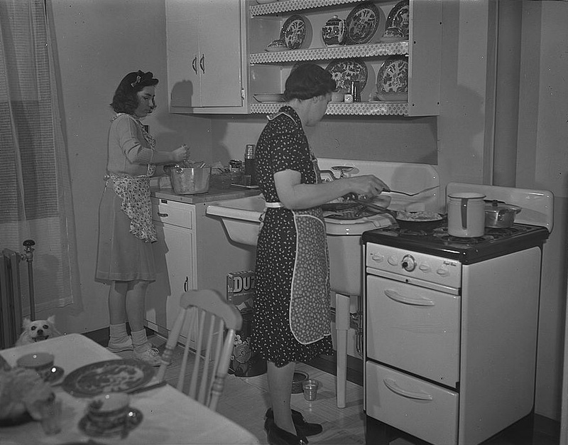 Photo: Mother and daughter in Bay Village apartment kitchen, 1942