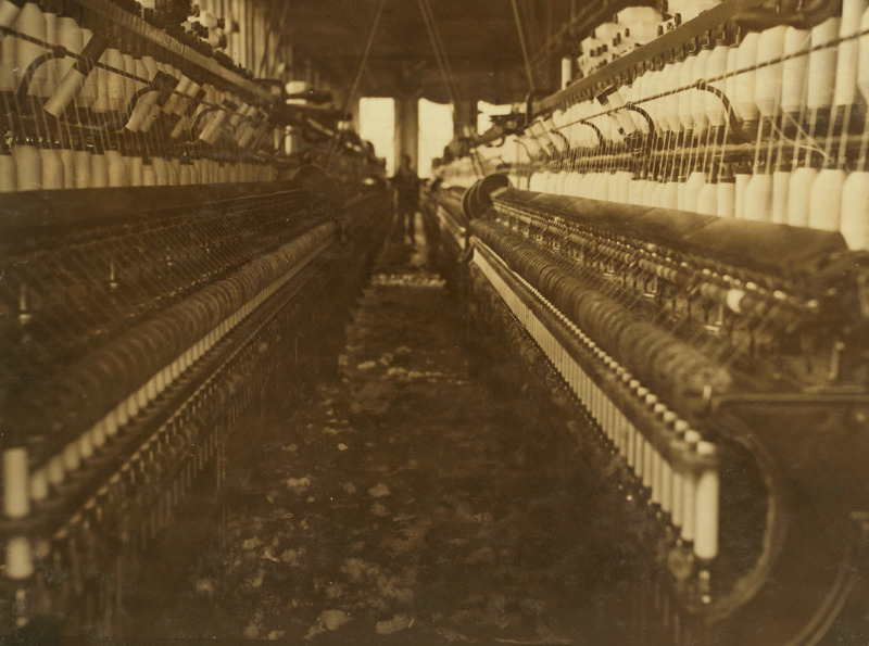 """""""View in a Pawtucket, R.I., cotton mill showing accumulation of lint on floor. The air is full of it too, but photo doesn't show it."""""""